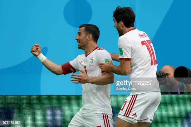 Hajsafi Ehsan#3 and Omid Ebrahimi of Iran celebrates their first goal against Morocco during the 2018 FIFA World Cup Russia group B match between...