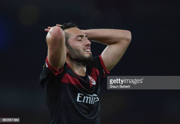 Haka Calhanoglu of AC Milan reacts during the UEFA Europa League Round of 16 second leg match between Arsenal and AC Milan at Emirates Stadium on...