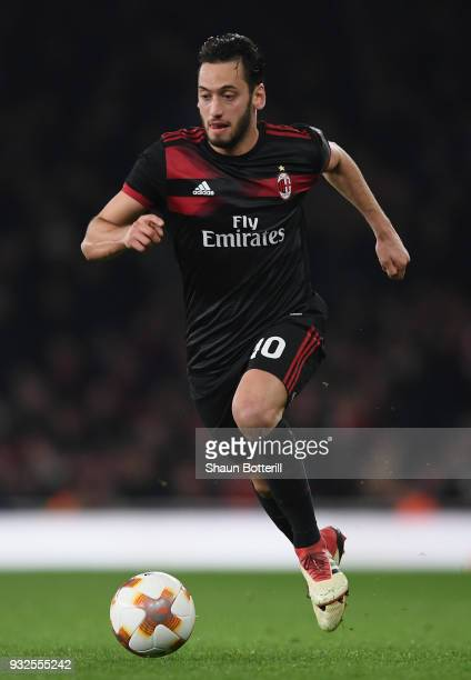 Haka Calhanoglu of AC Milan runs with ball during the UEFA Europa League Round of 16 second leg match between Arsenal and AC Milan at Emirates...