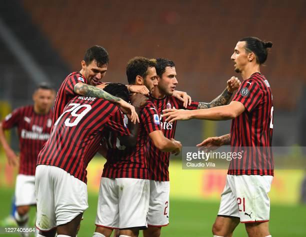 Hakan Çalhanoglu of AC Milan celebrates after scoring the third goal during the Serie A match between AC Milan and Parma Calcio at Stadio Giuseppe...