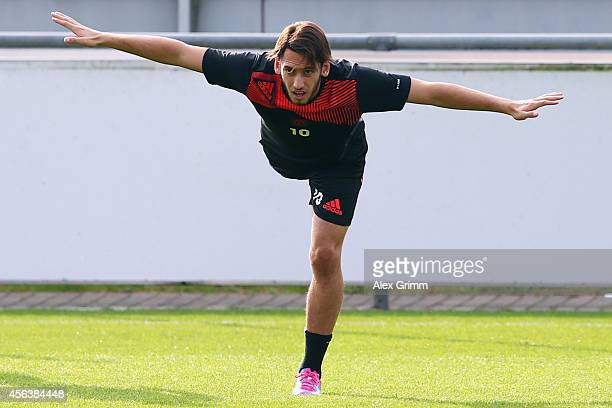 Hakan Calhanoglu exercises during a Bayer Leverkusen training session ahead of their UEFA Champions League Group C match against SL Benfica at...