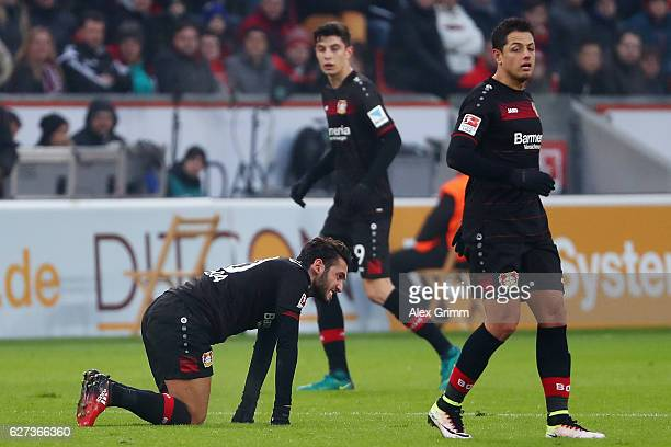 Hakan Calhanoglu Javier Hernandez and Kai Havertz of Leverkusen react during the Bundesliga match between Bayer 04 Leverkusen and SC Freiburg at...