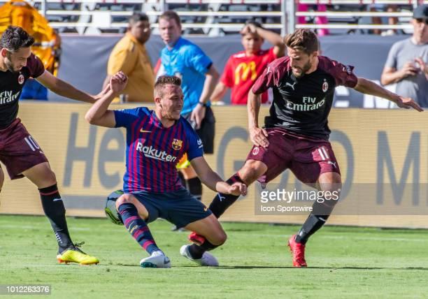 Hakan Calhanoglu Midfielder, AC Milan and Fabio Borini Midfielder, AC Milan attach Arthur Melo Midfielder, FC Barcelona during the International...