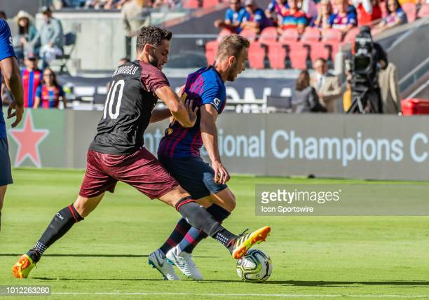 Hakan Calhanoglu Midfielder, AC Milan moves Arthur Melo Midfielder, FC Barcelona aside while reaching the ball from behind during the International...