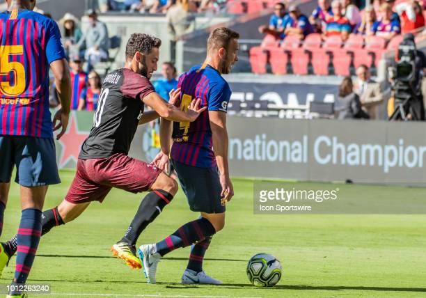 Hakan Calhanoglu Midfielder, AC Milan moves in on Arthur Melo Midfielder, FC Barcelona during the International Champions Cup match between AC Milan...