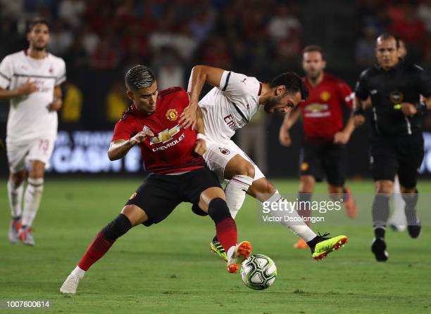 Hakan Calhanoglu of AC Milan and Andreas Pereira of Manchester United vie for the ball during the first half of the International Champions Cup 2018...
