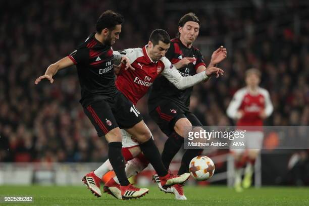Hakan Calhanoglu of AC Milan and Henrikh Mkhitaryan of Arsenal and Riccardo Montolivo of AC Milan during the UEFA Europa League Round of 16 Second...