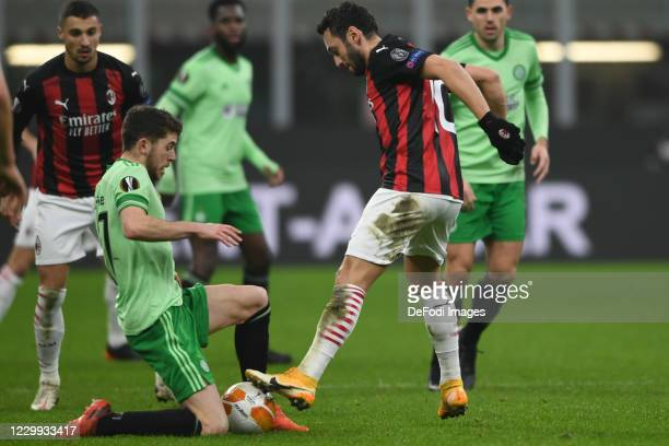 Hakan Calhanoglu of AC Milan and Ryan Christie of FC Celtic Glasgow battle for the ball during the UEFA Europa League Group H stage match between AC...