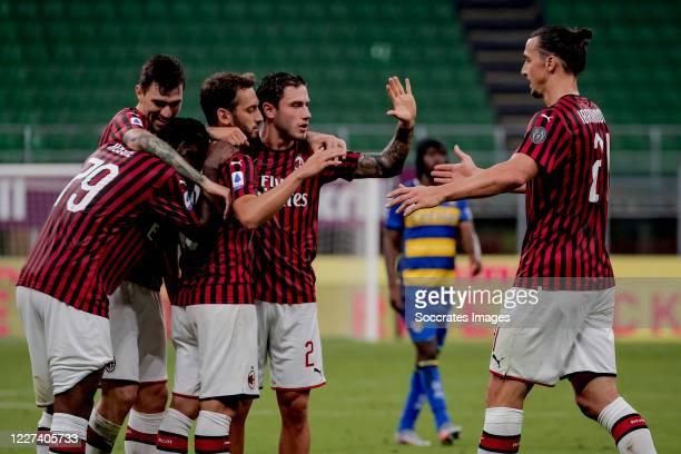 Hakan Calhanoglu of AC Milan celebrates 3-1 with Franck Kessie of AC Milan, Davide Calabria of AC Milan, Alessio Romagnoli of AC Milan, Zlatan...