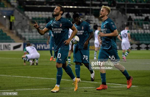 Hakan Calhanoglu of AC Milan celebrates after scoring his sides second goal during the UEFA Europa League second qualifying round match between...