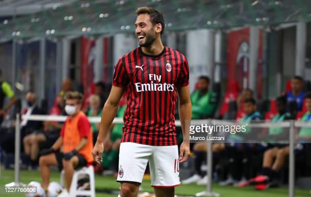 Hakan Calhanoglu of AC Milan celebrates after scoring the opening goal during the Serie A match between AC Milan and Atalanta BC at Stadio Giuseppe...