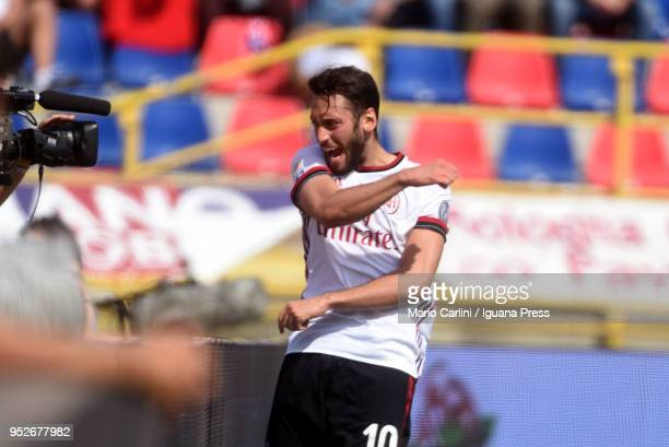 Hakan Calhanoglu of AC Milan celebrates after scoring the opening goal during the serie A match between Bologna FC and AC Milan at Stadio Renato...