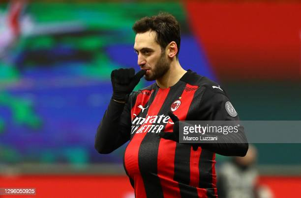 Hakan Calhanoglu of A.C. Milan celebrates after scoring the winning penalty during a penalty shoot out during the Coppa Italia match between AC Milan...