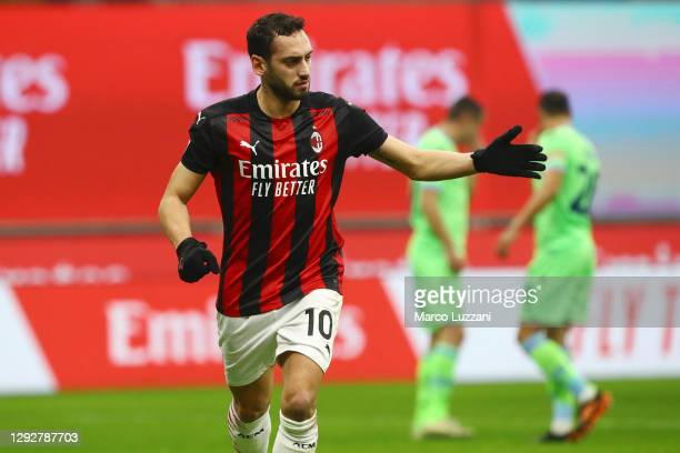 Hakan Calhanoglu of AC Milan celebrates after scoring their sides second goal during the Serie A match between AC Milan and SS Lazio at Stadio...