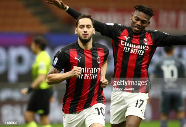 Hakan Calhanoglu of A.C. Milan celebrates after scoring their side's first goal during the Serie A match between AC Milan and Benevento Calcio at...