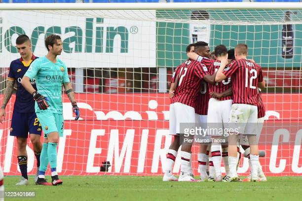 Hakan Calhanoglu of AC Milan celebrates his first goal on penalty during the Serie A match between AC Milan and AS Roma at Stadio Giuseppe Meazza on...