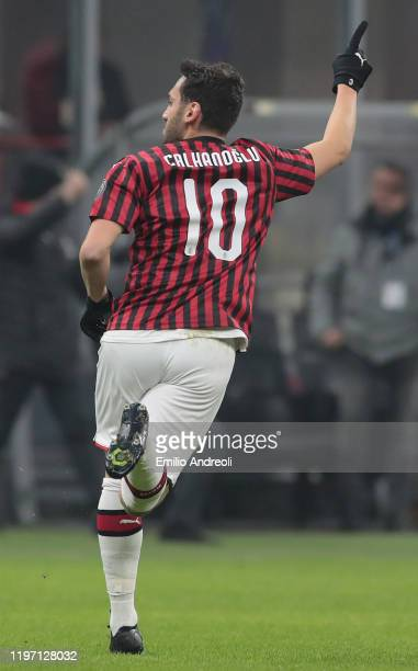 Hakan Calhanoglu of AC Milan celebrates his goal during the Coppa Italia Quarter Final match between AC Milan and Torino at San Siro on January 28...