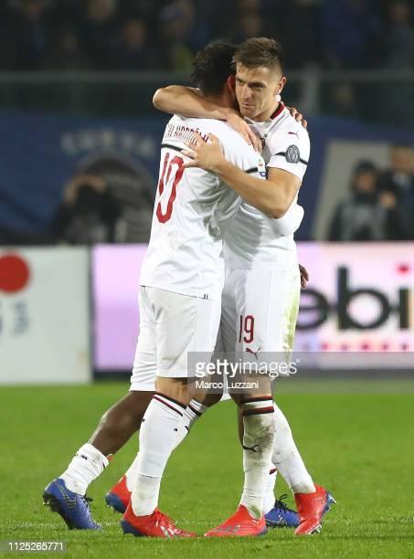 Hakan Calhanoglu of AC Milan celebrates his goal with his teammate Krzysztof Piatek during the Serie A match between Atalanta BC and AC Milan at...