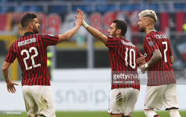 Hakan Calhanoglu of AC Milan celebrates his goal with his teammate Mateo Musacchio during the Serie A match between AC Milan and Hellas Verona at...