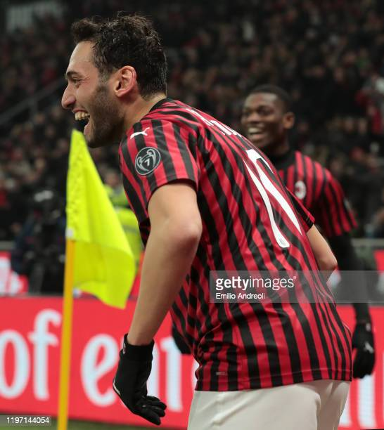 Hakan Calhanoglu of AC Milan celebrates his second goal during the Coppa Italia Quarter Final match between AC Milan and Torino at San Siro on...