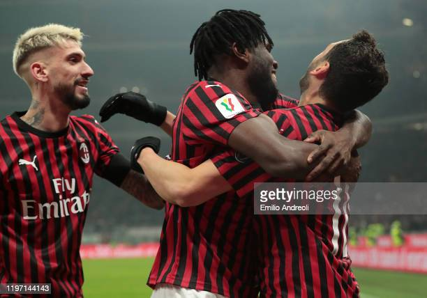 Hakan Calhanoglu of AC Milan celebrates his second goal with his teammates Frank Kessie and Samuel Castillejo during the Coppa Italia Quarter Final...