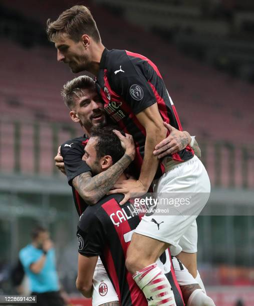 Hakan Calhanoglu of AC Milan celebrates his second goal with his teammate Samuel Castillejo and Matteo Gabbia during the UEFA Europa League third...