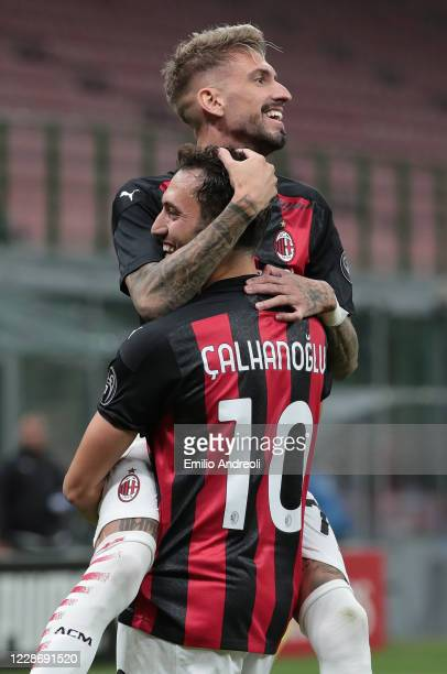 Hakan Calhanoglu of AC Milan celebrates his second goal with his teammate Samuel Castillejo during the UEFA Europa League third qualifying round...