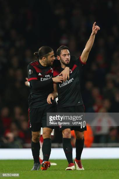 Hakan Calhanoglu of AC Milan celebrates scoring a goal during the UEFA Europa League Round of 16 second leg match between Arsenal and AC Milan at...