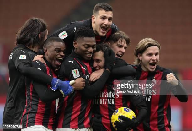 Hakan Calhanoglu of AC Milan celebrates the victory after scores his penalty with his team-mates Rafael Leao, Pierre Kalulu, Ciprian Tatarusanu, Jens...