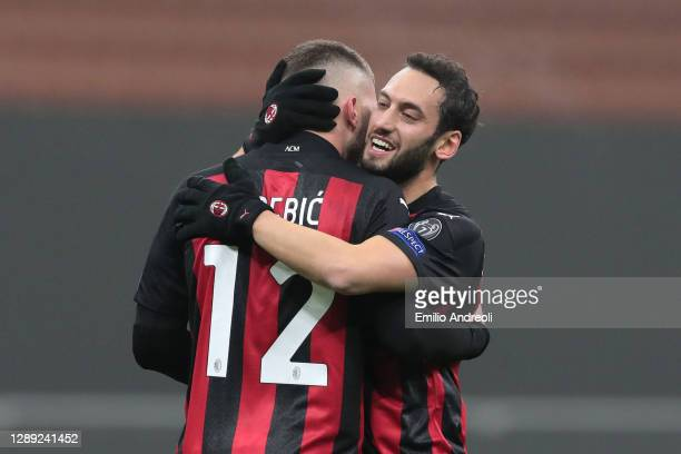Hakan Calhanoglu of A.C. Milan celebrates with Ante Rebic after scoring their team's first goal during the UEFA Europa League Group H stage match...