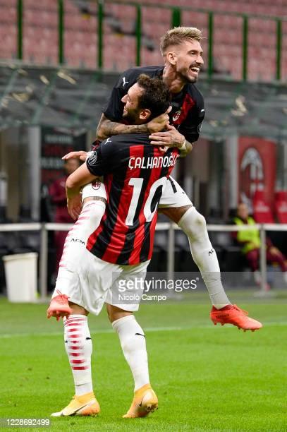 Hakan Calhanoglu of AC Milan celebrates with Samu Castillejo of AC Milan after scoring a goal during the UEFA Europa League Third Qualifying Round...