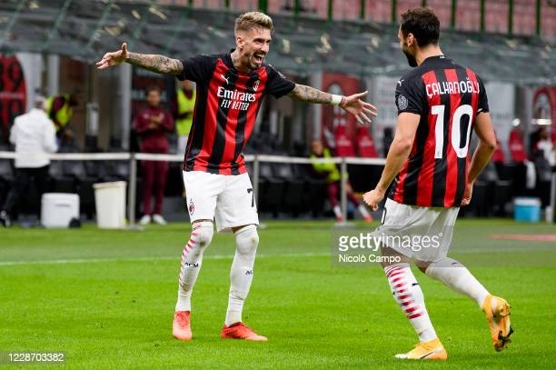 Hakan Calhanoglu of AC Milan celebrates with Samu Castillejo of AC Milan after scoring a gaol during the UEFA Europa League Third Qualifying Round...