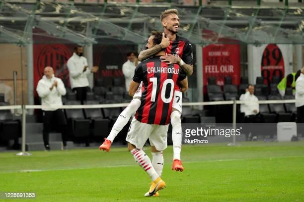 Hakan Calhanoglu of AC Milan celebrates with Samuel Castillejo of AC Milan after scoring the goal during the UEFA Europa League Third Qualifying...