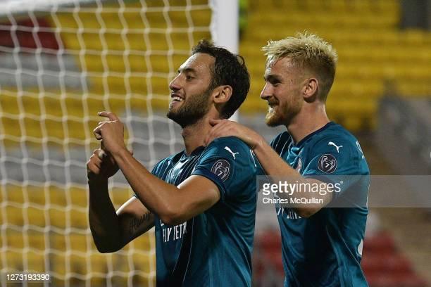 Hakan Calhanoglu of AC Milan celebrates with teammate Alexis Saelemaekers of AC Milan after scoring his team's second goal during the UEFA Europa...