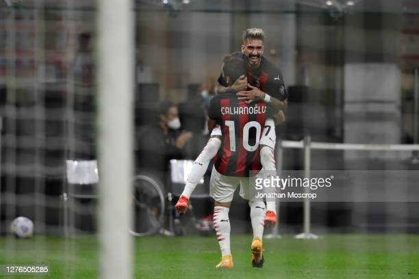 Hakan Calhanoglu of AC Milan clebrates with team mate Samuel Castillejo after scoring his second goal to give the side a 31 lead during the UEFA...