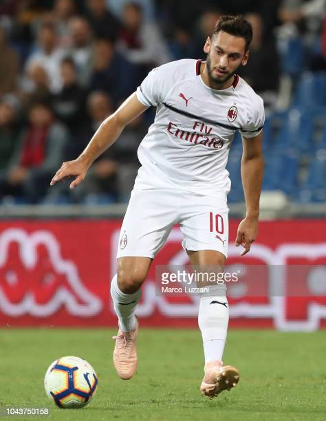 Hakan Calhanoglu of AC Milan controls the ball during the Serie A match between US Sassuolo and AC Milan at Mapei Stadium Citta' del Tricolore on...