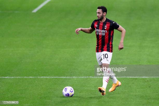 Hakan Calhanoglu of AC Milan controls the ball during the Serie A match between AC Milan and AS Roma at Stadio Giuseppe Meazza on October 26 2020 in...