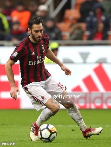 Hakan Calhanoglu of AC Milan controls the ball during the serie A match between AC Milan and AC Chievo Verona at Stadio Giuseppe Meazza on March 18...