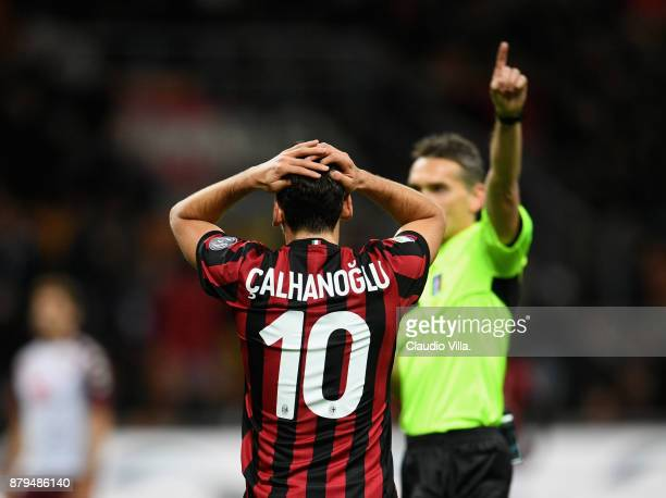 Hakan Calhanoglu of AC Milan dejected during the Serie A match between AC Milan and Torino FC at Stadio Giuseppe Meazza on November 26 2017 in Milan...