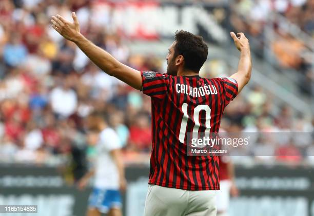 Hakan Calhanoglu of AC Milan gestures during the Serie A match between AC Milan and Brescia Calcio at Stadio Giuseppe Meazza on September 1 2019 in...
