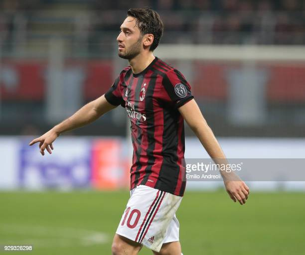 Hakan Calhanoglu of AC Milan gestures during UEFA Europa League Round of 16 match between AC Milan and Arsenal at Stadio Giuseppe Meazza on March 8...