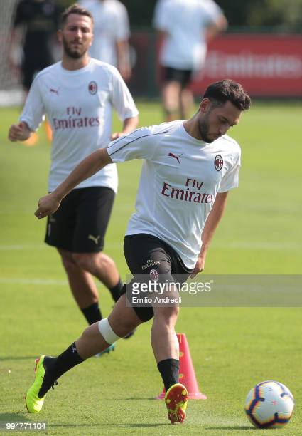 Hakan Calhanoglu of AC Milan in action during the AC Milan training session at the club's training ground Milanello on July 9, 2018 in Solbiate Arno,...