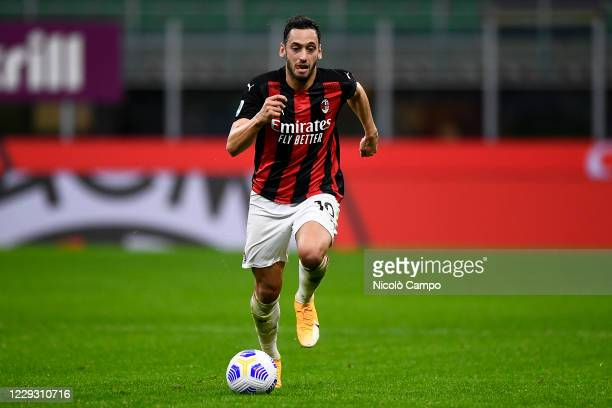 Hakan Calhanoglu of AC Milan in action during the Serie A football match between AC Milan and AS Roma The match ended 33 tie