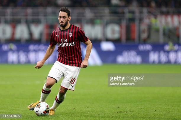 Hakan Calhanoglu of Ac Milan in action during the Serie A match between Ac Milan and Us Lecce. The match ends in a draw 2 - 2.