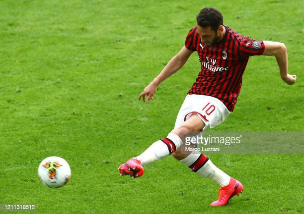 Hakan Calhanoglu of AC Milan in action during the Serie A match between AC Milan and Genoa CFC at Stadio Giuseppe Meazza on March 8, 2020 in Milan,...