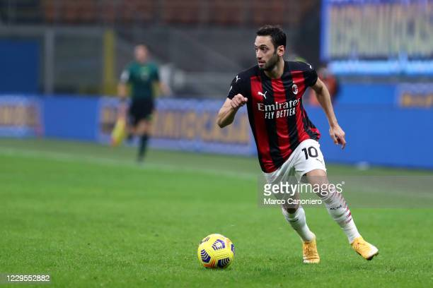 Hakan Calhanoglu of Ac Milan in action during the Serie A match between Ac Milan and Hellas Verona. The match end in a tie 2-2.