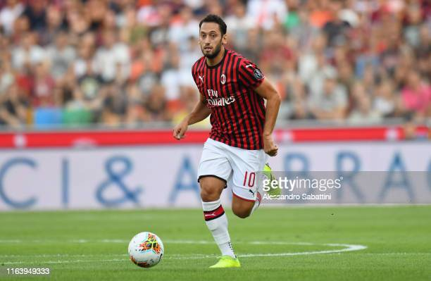 Hakan Calhanoglu of AC MIlan in action during the Serie A match between Udinese Calcio and AC Milan at Stadio Friuli on August 25, 2019 in Udine,...