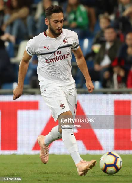 Hakan Calhanoglu of AC Milan in action during the Serie A match between US Sassuolo and AC Milan at Mapei Stadium Citta' del Tricolore on September...
