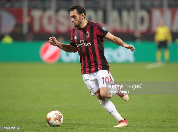 Hakan Calhanoglu of AC Milan in action during UEFA Europa League Round of 16 match between AC Milan and Arsenal at Stadio Giuseppe Meazza on March 8...