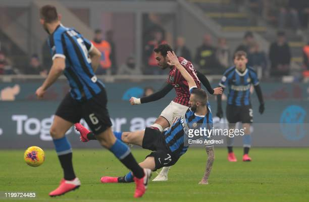 Hakan Calhanoglu of AC Milan kicks the ball and hits the post during the Serie A match between FC Internazionale and AC Milan at Stadio Giuseppe...